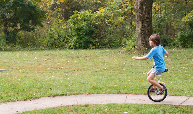 A young unicycle rider